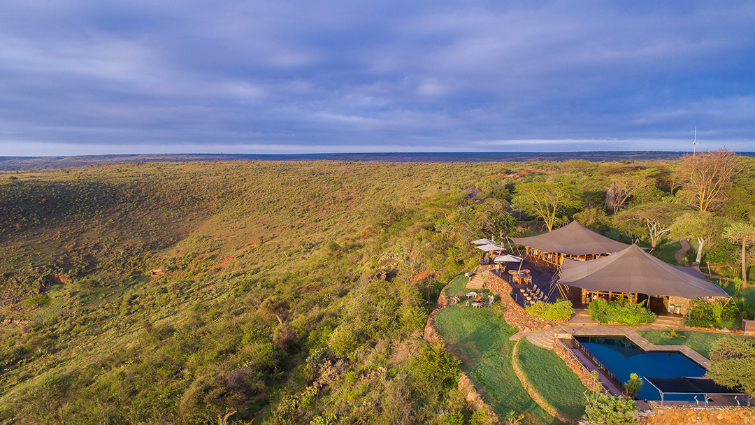 Elewana-Loisaba-Tented-Camp-aerial-view--Loisabas-picturesque-infinity-pool-c-Mario-Moreno